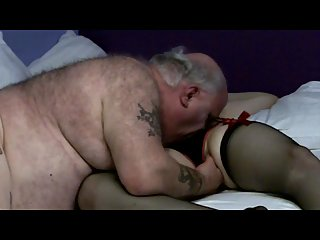 Mature guy plays with a crossdresser