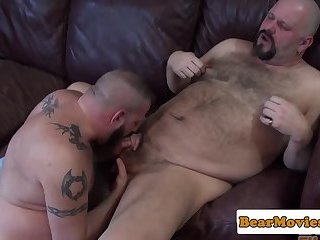 Chubby bear sucking cock on his knees