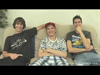 Three Twinks Relaxing On A Couch
