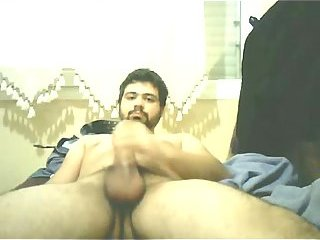 Bearded dude masturbates by webcam