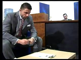 Cumming on the tie in the office