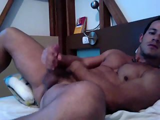 Handsome dude masturbates at home