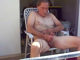 Mature pissing on the veranda