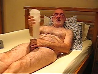Old Bear Pumping Cock On A Bed