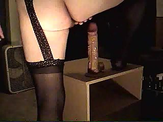 Solo dildo fucking in stockings