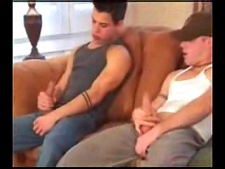 Teen gays threesome on a sofa
