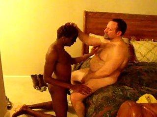 Bound ebony sucks white dick