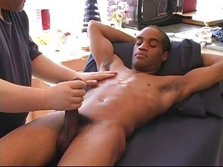 Ebony guy gets rod sucked by white masseur