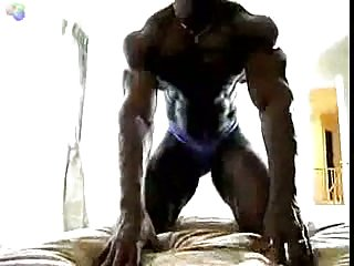 Ebony Body Builder Playing With His Muscles
