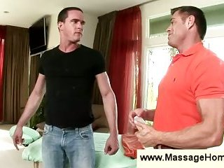 Muscular gay dude feels up a guy