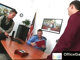 Trio sexy gay studs at the office kissing