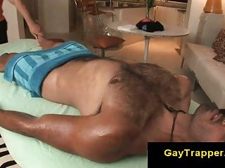 Hairy straight guy gets massage from gay stud