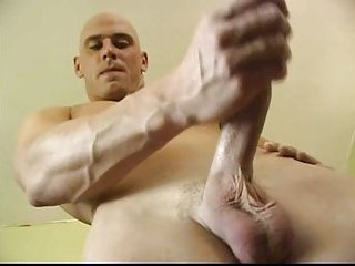 Blue Eyed Hunk Plays With His Erect Cock