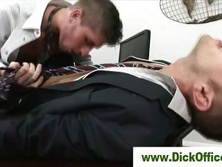 Two gay businessmen french kissing