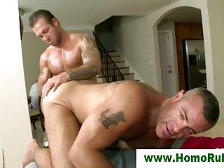 Hunk shoves dildo up masseurs ass