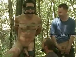 Sexy boy tied from tree in the forest