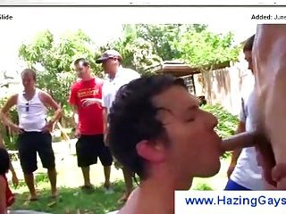 Boys take turns sucking a hazing leader