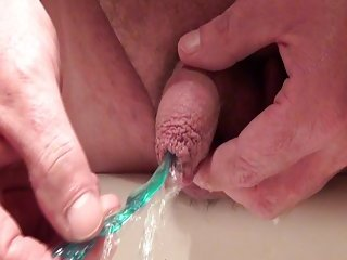 Amateur Guy Pissing With An Object In His Penis