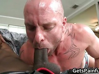 Pierced sack gets hard black anal ramming