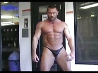 Strong body builders show their bodies