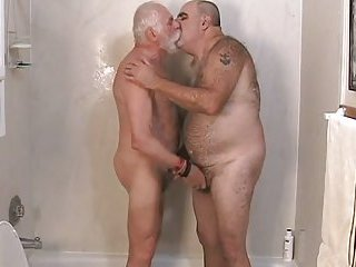 Mature studs pet each other