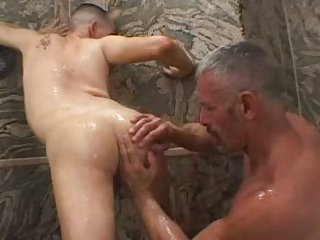 Mature dude drills twink with dildo
