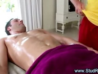 Gay stud masseur sucks his straight client