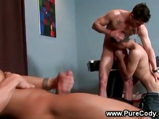 Hot jock wanks his throbbing cock while other guys get hot