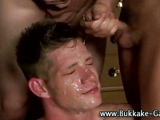 Gay gets bukkake before anal