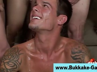 Real gay guy sucks big cocks and gets bukkake in gangbang