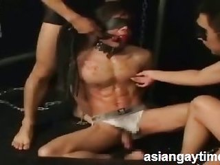 A sizzling candle dripping gay bondage delight