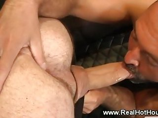 Gay pornstar sucks cocks at a gangbang