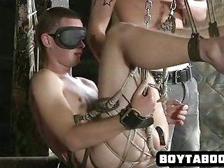 Hot blindfolded hunk taking different toys in his ass