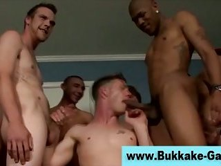 Interracial bukkake orgy soaks twink