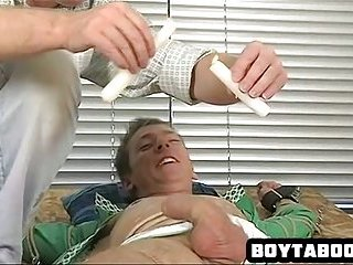 Horny tied up hunk gets some wax and gets a handjob