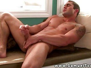 Muscular gay pornstar gets tugging his dick