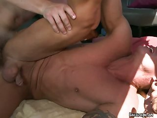 Hot stud slams his cock into ass in a van