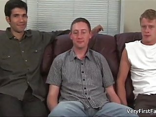 Two aroused gay hunks meet on the sofa