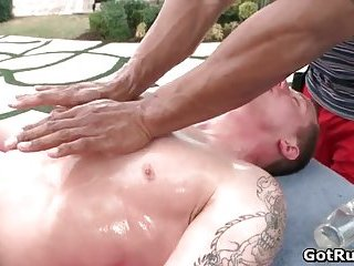 Great outdoor massage by two ripped hunks