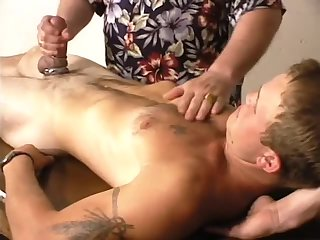 Mature dude handjobing guy cock