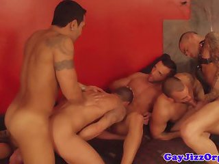 BDSM muscled hunk enjoying great orgy