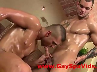 Oiled muscled gay guys sucking cock after massage