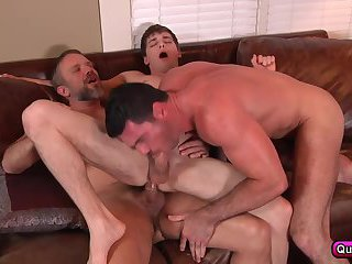 Two bears fuck a twink in this awesome threesome