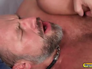 Bearded twink gets an anal drilling by Daddy Bear after a mouthful blowjob