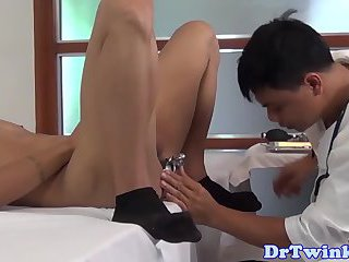 Asiantwink receives enema from doctor