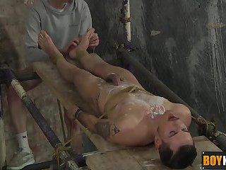 Ashton putting his cock between his feet and strokes it hard