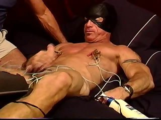 CBT homemade electrostim  device used to the extreme on a muscular and hung dude