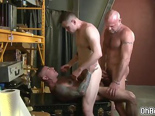 Gay threesome dicks stuffed in the mouth and in the ass