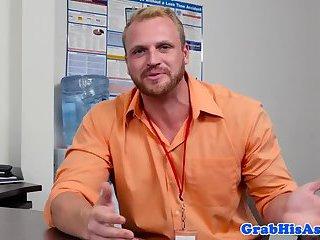 Muscular stud pounds bloke on office desk