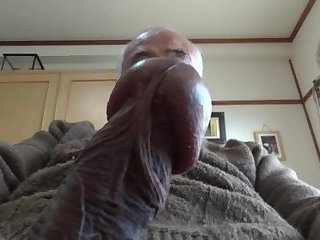Old man plays with his penis